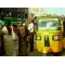 An Auto rikshaw causing a great problem at bus stop